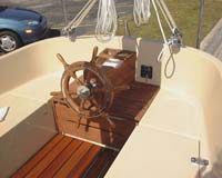 Steering station, standard teak wheel, and storage underneath