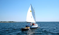 Sun Cat under sail and towing dinghy on Georgian Bay